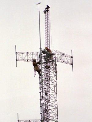 A radio antenna tower near Lansing.