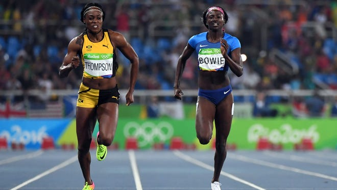 The United States' Tori Bowie, right, won bronze in the women's 200 meters Wednesday night. The former Southern Miss star and Sandhill native ran a time of 21.15. Jamaica's Elaine Thomson, left, won with a time of 21.78