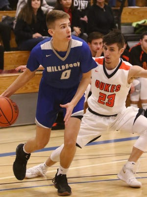 Millbrook's Jake Daly looks for an open teammate as Malrboro's Austin Casey covers him during the MHAL boys basketball championship at SUNY Ulster in 2018.