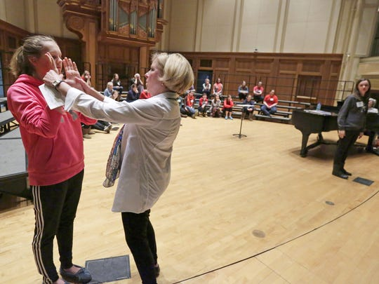 Conductor Debbie Lind helps Claire Boldt with position