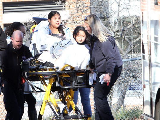 An injured student is wheeled to an awaiting ambulance