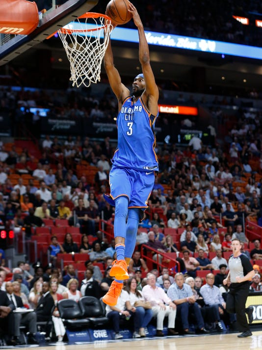 Oklahoma City Thunder forward Corey Brewer (3) dunks the ball during the first half of an NBA basketball game against the Miami Heat, Monday, April 9, 2018, in Miami. (AP Photo/Wilfredo Lee)