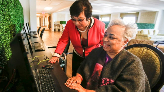 Dr. Stella Evangelista, medical director and administrator at Maple Manor Rehab in Novi, Mich., visits with Annena McCleskey, 70, as she browses the Internet on one of four computers available for residents of the rehab facility.