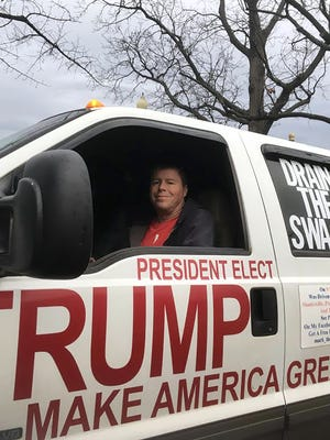 Mark Hoffman, an arcade vendor from Columbus, Ohio, who drove from his home to be at the Trump Inaugural.  He's in his Trump Truck.