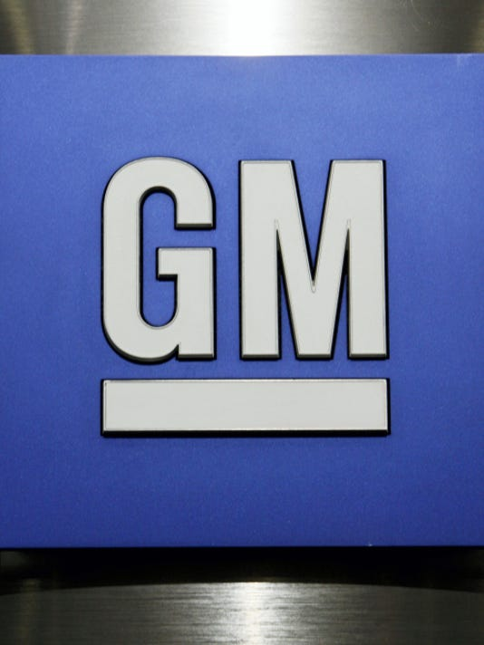 FILE - This Jan. 25, 2010, file photo, shows a General Motors Co. logo during a news conference in Detroit. General Motors Co. For the third time in eight years, General Motors is recalling cars that can leak oil and catch fire, sometimes damaging garages and houses. The recall, which covers 1.4 million vehicles dating to the 1997 model year, is needed because repairs from the first two didn't work. More than 1,300 cars caught fire after they were fixed by dealers, the company said. (AP Photo/Paul Sancya, File)