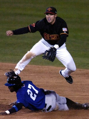 Rochester SS Jason Bartlett goes over the hard slide of Norfolk's Lastings Milledge to complete the double play on hitter Jeff Keppinger in the 5th inning. (042106 Staff Photo by Jamie Germano, Democrat & Chronicle, )