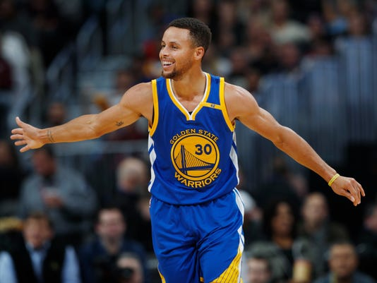 FILE - In this Nov. 10, 2016, file photo, Golden State Warriors guard Stephen Curry celebrates after hitting a 3-point basket and drawing a foul from the Denver Nuggets during the second half of an NBA basketball game, in Denver. The 2017 NBA Champion Golden State Warriors  signed Stephen Curry, Kevin Durant, Andre Iguodala, Shaun Livingston, Zaza Pachulia and David West to contracts, the team announced Tuesday, July 25, 2017. (AP Photo/David Zalubowski, File)