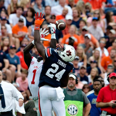 Auburn defensive back Daniel Thomas (24) deflects a