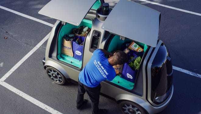 This undated photo provided by The Kroger Co. shows a driverless car that the Cincinnati-based company is about to test whether it can steer supermarket customers away from crowded grocery aisles with a fleet of diminutive driverless cars designed to lower delivery costs. The test program announced Thursday, June 28, 2018, could make Kroger the first U.S. grocer to make deliveries with robotic cars that won't have a human riding along to take control in case something goes wrong. (Andrew Brown/The Kroger Co. via AP)