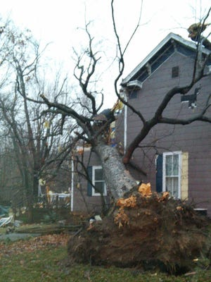 Several homes and garages in Greenwood were damaged as a storm passed though Indiana Wednesday, Dec. 23, 2015.
