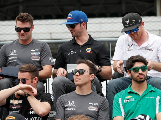 MeyerShank Racing IndyCar driver Jack Harvey (60),left, Andretti Autosport IndyCar driver Alexander Rossi (27) and Dale Coyne Racing IndyCar driver Conor Daly (17) look at their rings during the public drivers meeting during Legends Day at the Indianapolis Motor Speedway on Saturday, May 26, 2018.