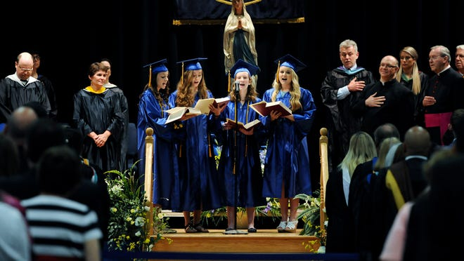 The Our Lady of Lourdes High School senior ensemble sings the National Anthem at commencement ceremonies on campus on Saturday in the Town of Poughkeepsie.