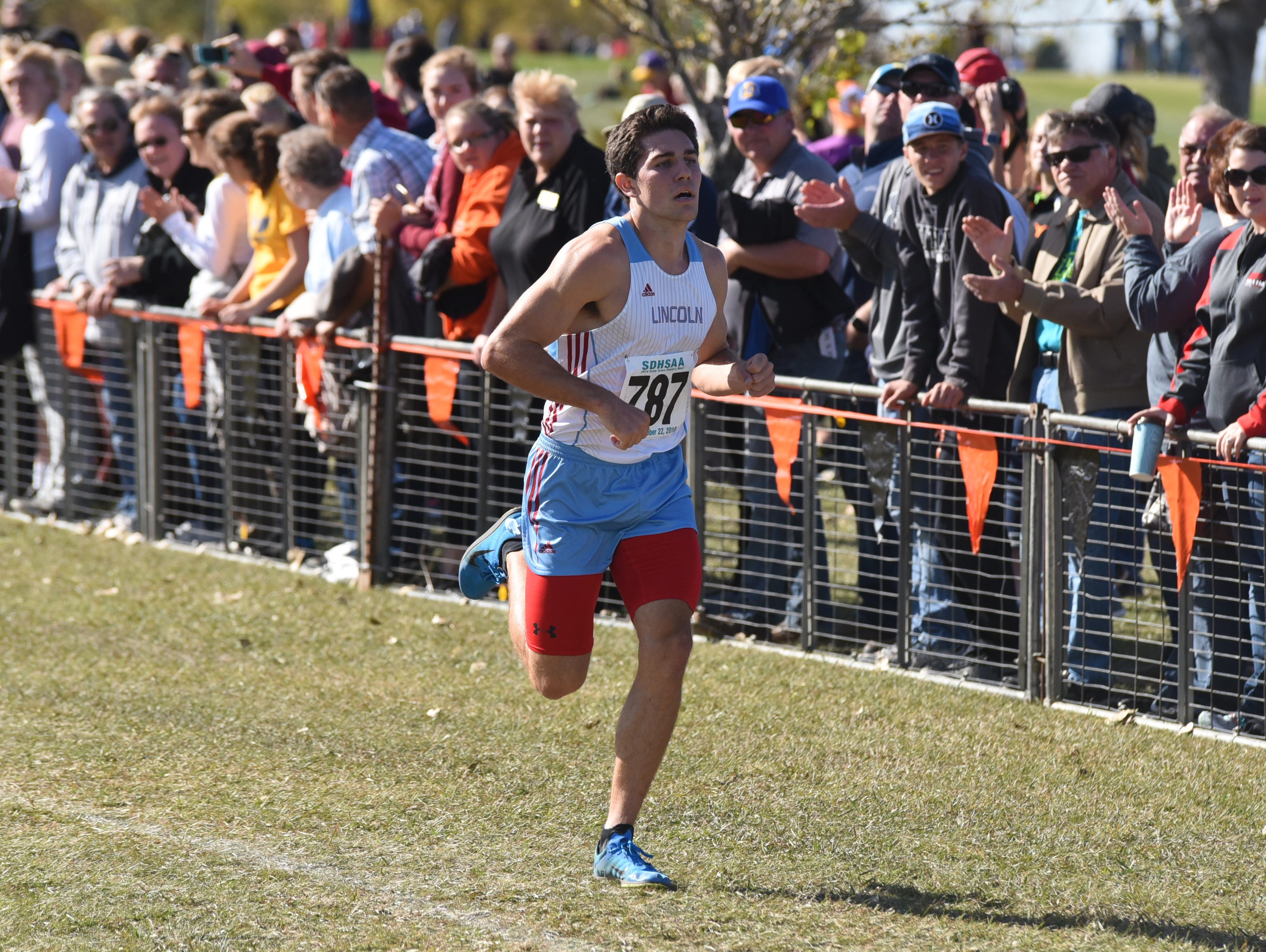 Sioux Falls Lincoln senior Gabe Peters races to victory in the Class AA boys' race at the South Dakota State Cross Country Meet on Saturday in Huron. Peters defended his individual title and led the Patriots to the team title.