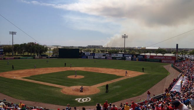 A controlled burn (see from Space Coast Stadium) just outside of the Melbourne city line is expected to continue into the evening, Florida Division of Forestry officials report.