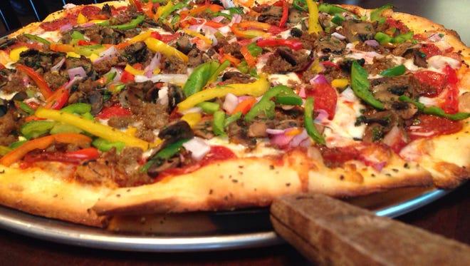 Blue Moon Pizza celebrates grand opening ribbon cutting Thursday.
