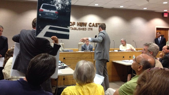 Ronald Steinvurzel, in gray suit, shows photos of existing parking problems to the New Castle Zoning Board of Appeals as he argues against permits for a mosque and Islamic center proposed by the Upper Westchester Muslim Society on Pines Bridge Road at a hearing Wednesday, July 30, 2014.
