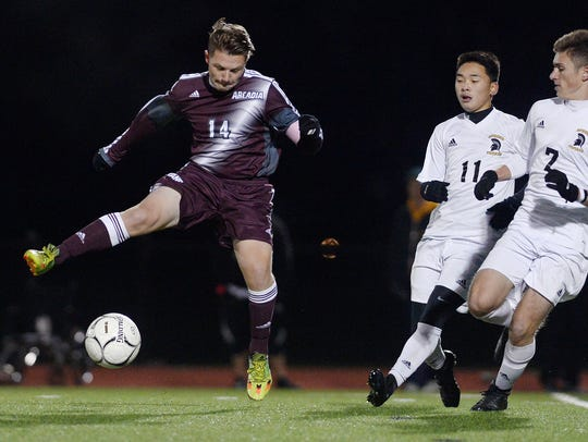 Greece Arcadia's Tyler Lewandowski, left, tries to
