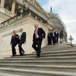 Members of Congress and aides leave the Capitol on Dec. 18, 2015.