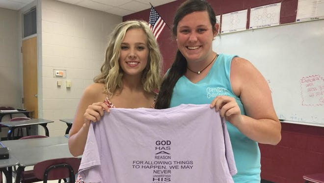 Pass Christian High School senior Allison Hennessey shows the T-shirt that her friend Jettie Necaise designed for her.