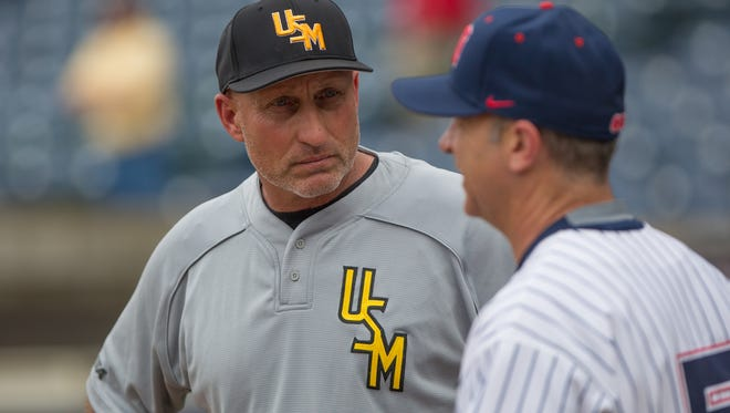 USM head baseball coach Scott Berry talks with Ole Miss head coach Mike Bianco prior to their game at Trustmark Park in Pearl on Tuesday, April 7, 2015. Photo by Keith Warren (Mandatory photo credit)