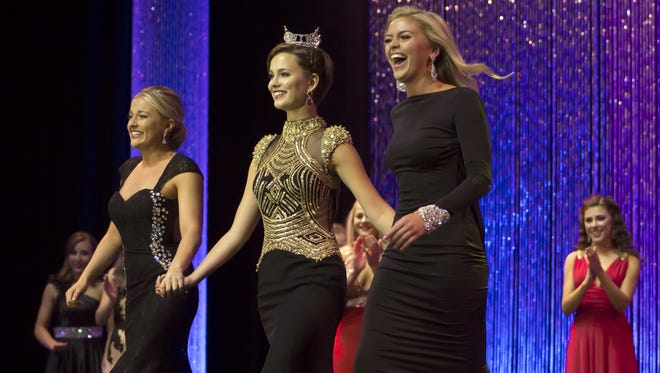 Miss Badgerland Catherine Smith, left, won the talent competition and Miss Wood Violet Malainey Myrin, right, won the lifestyle and fitness portion of Thursday's Miss Wisconsin preliminary scholarship pageant at the Alberta Kimball Auditorium walking with Miss Wisconsin Rosalie Smith on June 23, 2016.