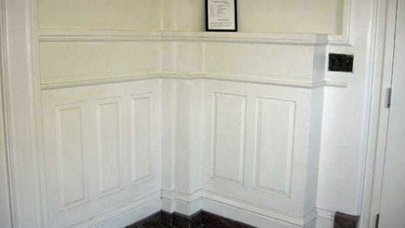 Carved paneling with marble baseboards
