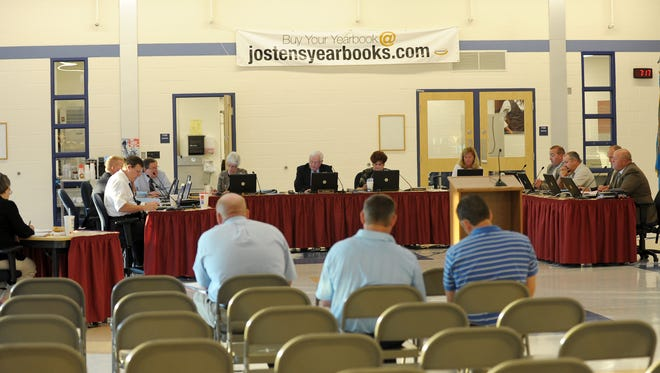 Indian River School Board Meeting in 2011. The district is being sued after an in-class experiment severely injured a student.