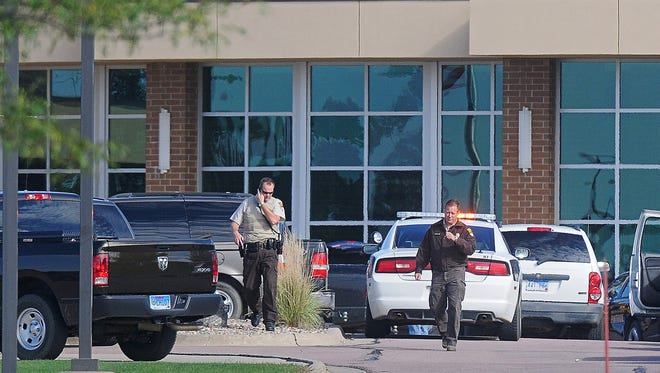 Law enforcement on scene after a shooting that injured Harrisburg High School principal Kevin Lein Wednesday, Sept. 30, 2015, at the Harrisburg High School in Harrisburg, S.D.