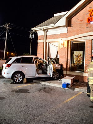 The car struck the corner of Tim Horton's in Chili on July 3, 2015.