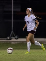 Henderson's Katie Bickers (16) dribbles downfield during