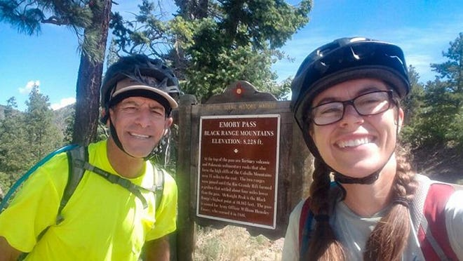 Kevin and Amy Compare pose while biking through New Mexico's Emory Pass, elevation 8,828 feet, on their ride from the Pacific Ocean to the Atlantic Ocean while raising more than $20,000 for nine charities.