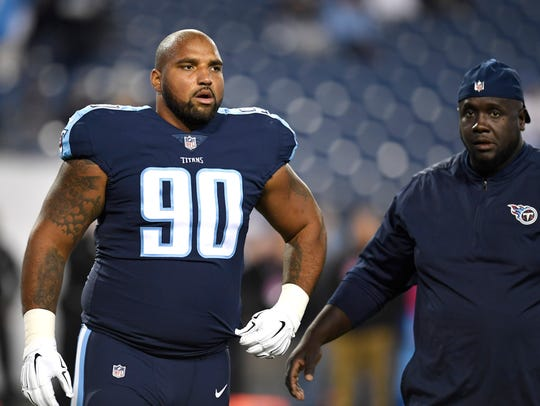 Titans defensive end DaQuan Jones (90) walks on the