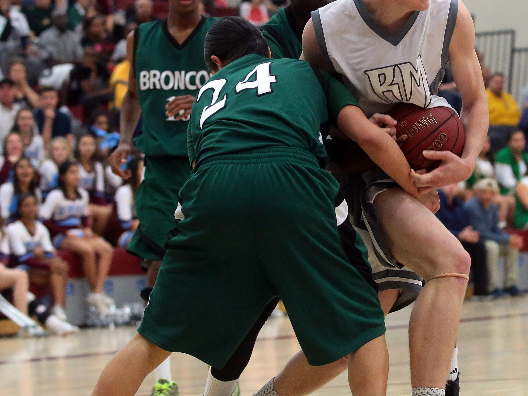 Rancho Mirage High School sophomore William Webster (44, white) fights for possession of the ball during the second half of the Rattlers' home playoff game on Wednesday, February 18, 2015 against Banning.