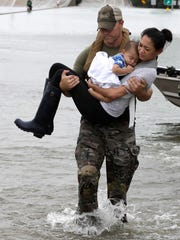 Houston Police SWAT officer Daryl Hudeck carries Catherine