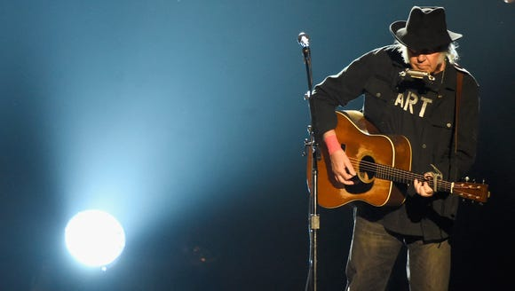 Neil Young performs at the 25th anniversary MusiCares