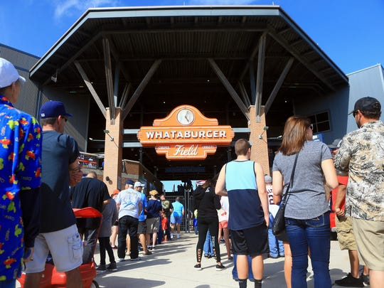 Fans stand in line as they prepare to watch the Hooks play against Arkansas during opening day Thursday, April 13, 2017, at Whataburger Field in Corpus Christi.