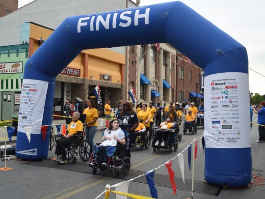 Participants in the Think Differently Dash cross the