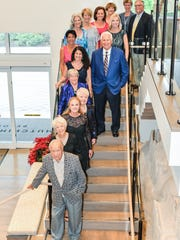 Representing The Library Foundation of Martin County are, front to back, Pres Blake, Helen Blake, Denise Ehrich, May Smyth, Meg Bradley, Stacy Ranieri, Karen Rodgers, Frank M. Byers Jr., Widget Webert, Noreen Fisher, Christine Delvecchio, Debbie Sopko, Joan Amerling, Leigh Garry, and Jim Sopko.