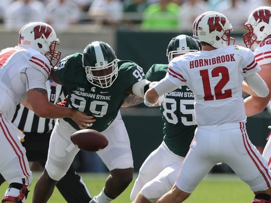 Michigan State Spartans' Raequan Williams forces a
