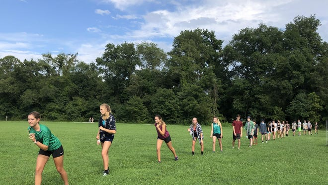 West Henderson High School's cross country team participates in a workout earlier this week at West.