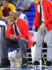 """Memphis East assistant coach Anfernee """"Penny"""" Hardaway, a former NBA player, coaches on the sidelines next to the head coach of Memphis East, Robert Jackson, during the state tournament quarterfinal game against Hillsboro, on Wednesday March 16, 2016, at MTSU."""