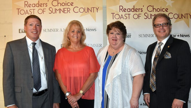 Jay Roney, left, Lisa Looper, Karen White and Jason Kotler accept the Best Bank award for CapStar Bank at Readers' Choice Toast of Sumner County at the Epic Event Centre in Gallatin on Thursday, June 23, 2016.