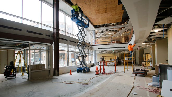 Crews work in the future entryway of the new Herbert-Herman Cancer Center May 4, 2017.  [MATTHEW DAE SMITH/Lansing State Journal]