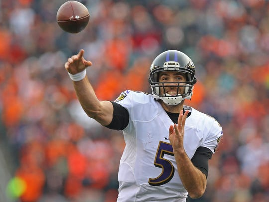 Baltimore Ravens quarterback Joe Flacco (5) throws a pass against the Cincinnati Bengals in the second half at Paul Brown Stadium. The Bengals won 27-10.