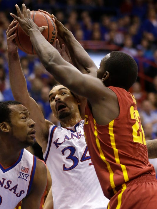 Kansas forward Perry Ellis (34) rebounds against Iowa State forward Dustin Hogue (22) during the first half of an NCAA college basketball game in Lawrence, Kan., Monday, Feb. 2, 2015. (AP Photo/Orlin Wagner)