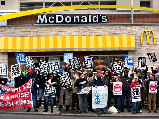 """""""Hold the burgers, hold the fries, make our wages super-size"""" was one of the chants as activists rally in support of a minimum wage increase Thursday, Dec.  4, 2014, at the McDonald's on Cumberland Avenue. Fast food workers in Knoxville on Thursday, April 14, 2016, plan to join those in Nashville and Memphis to rally in support of a nationwide effort for higher wages and union rights for minimum wage workers. (PAUL EFIRD/NEWS SENTINEL)"""