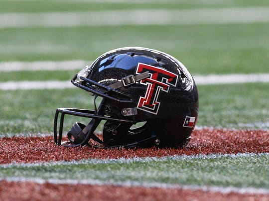 Texas Tech Red Raiders helmet and logo on the field before the game against the Baylor Bears at Cowboys Stadium.