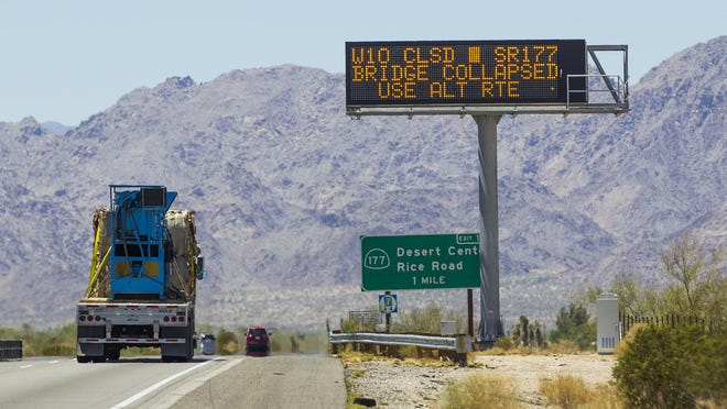 This is a warning sign in the westbound lanes of I-10, just west of Blythe, California, warning of the Tex Wash Bridge being washed out, Wednesday, July 21, 2015.