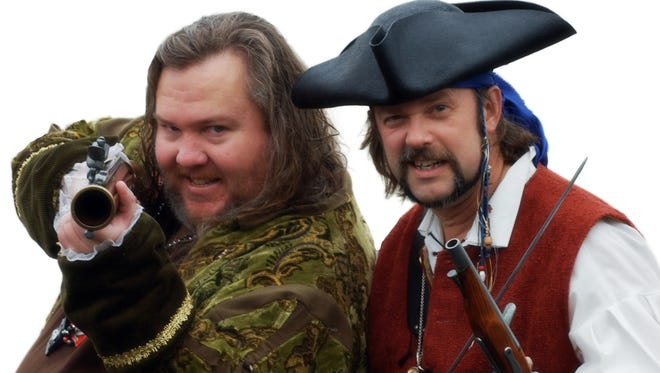 """The founders of Talk Like a Pirate Day, Mark """"Cap'n Slappy"""" Summers, left, and John """"Ol' Chumbucket"""" Baur strike their pirate poses."""