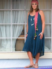 Olga Ganoudis wears an Ink blue velvet knee-length dress with spaghetti straps from TJ Maxx; beaded scarf with mother of pearl detailing by Chan Luu from Henri Bendel; and flat sandals with rhinestone trim by Barbara Barbieri.